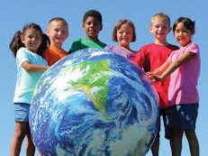 six diverse children around a globe